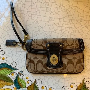 COACH Signature logo wristlet with colorful lining